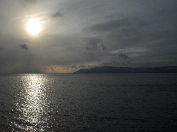 The sun hanging low over Lake Baikal