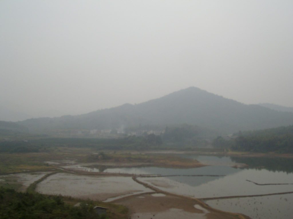 View through the train window of Guangdong on a smoggy day