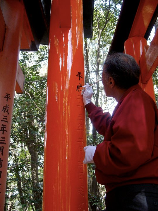 A gate being painted at Fushimi Inari