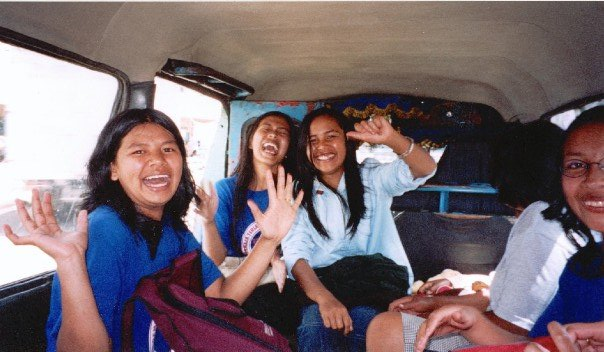 A minivan full of Berastagi schoolgirls laughing hysterically at us!