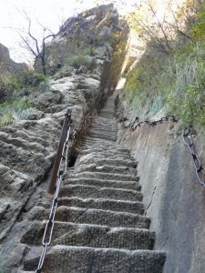 The Huashan trail includes these steep steps carved through the cliff face