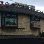 Communist propaganda posters in a Jiufen window