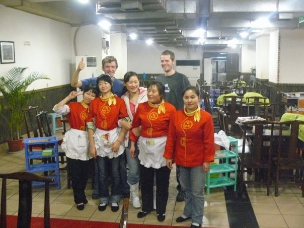 Posing for pics with the hotpot restaurant staff in Chongqing