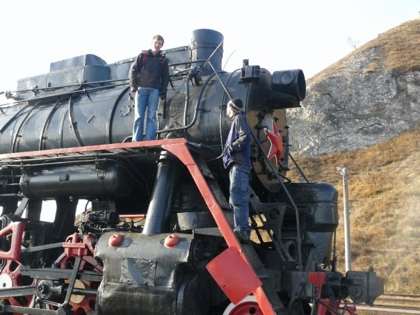 Clambering on the old locomotive engine parked at Port Baikal