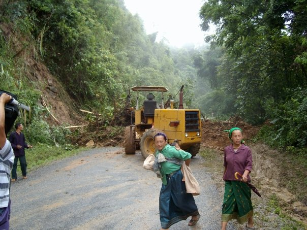 A bulldozer arrives to clear the landslide