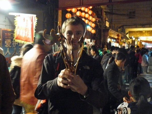 Mike enjoying Wangfujing snack street