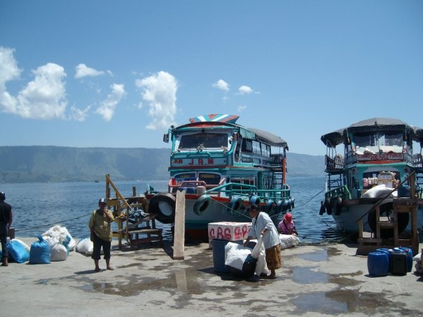 Boats ferrying passengers to Lake Toba's Samosir island