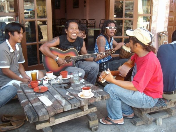 Batak guitarists jamming by Lake Toba