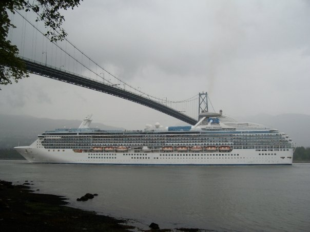 A cruise ship passing under the Lions Gate Bridge