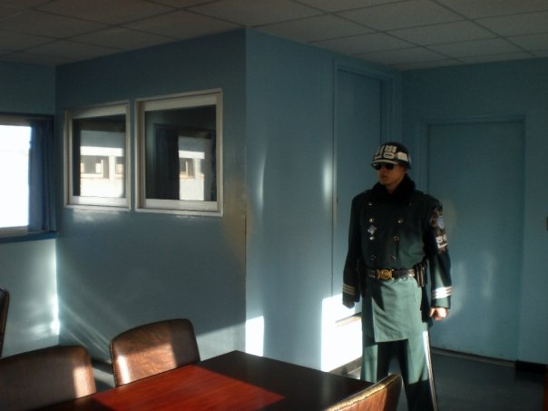 Korean soldier guarding the door to North Korea from the JSA negotiation hut