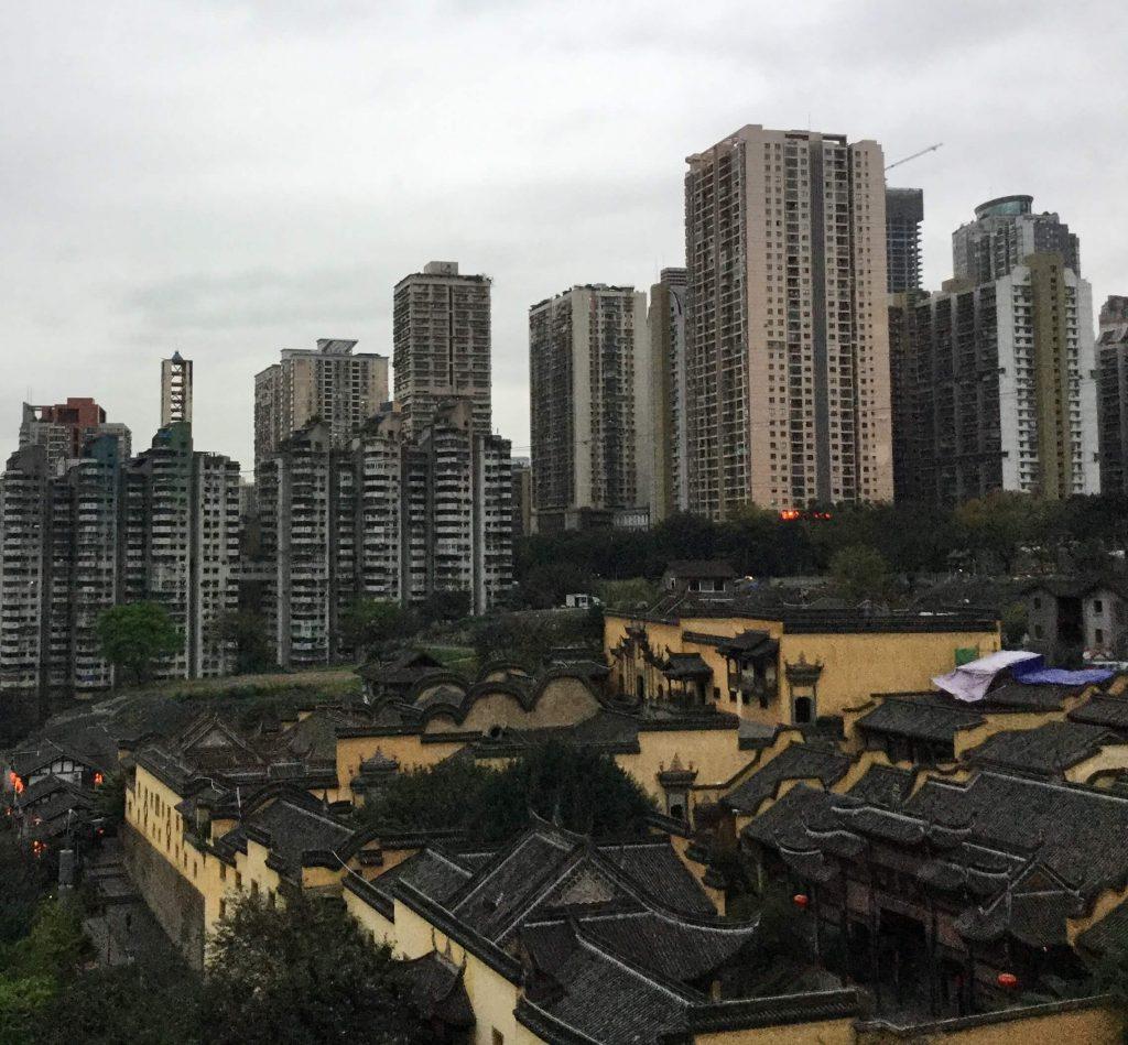 Modern tower blocks behind traditional buildings, Chongqing