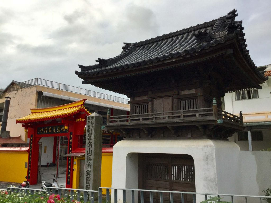 Contrasting Chinese and Japanese entrance gates to the Rinzai Zen temple in Yuanshan, Taipei