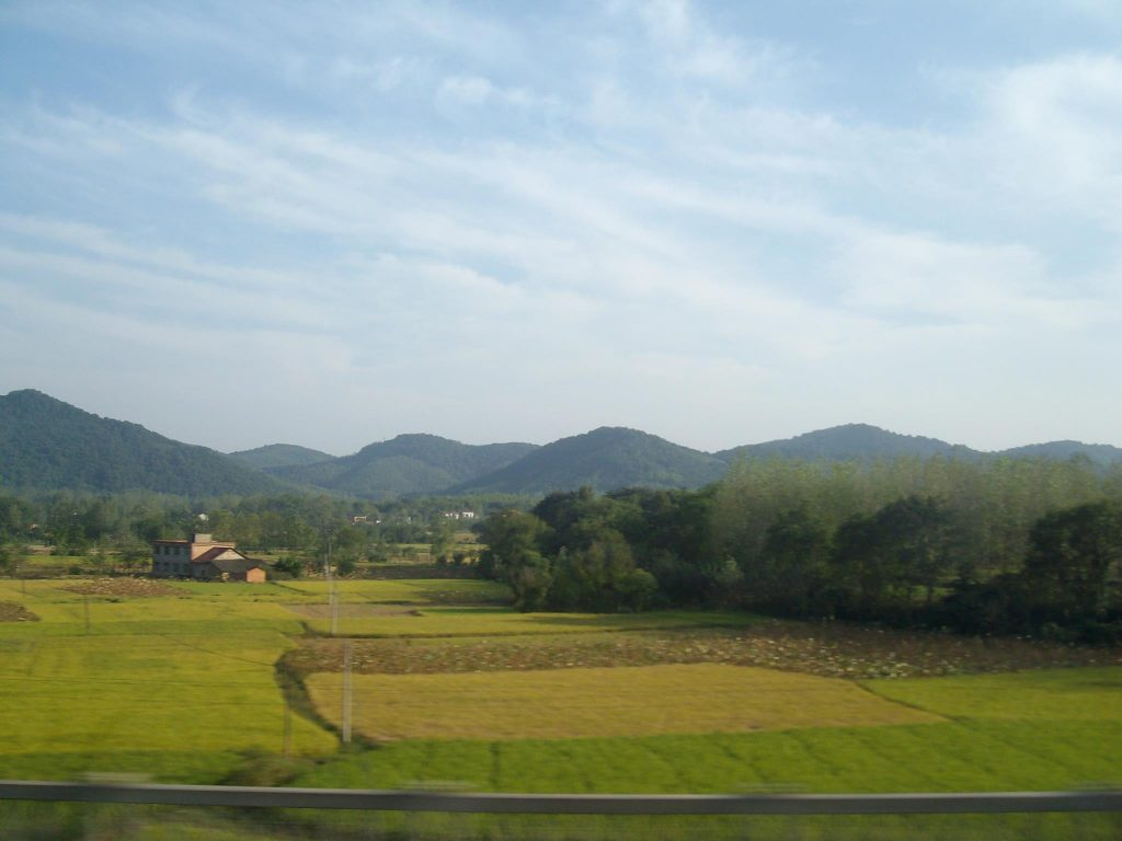 View through the train window of Guangdong on a clear day