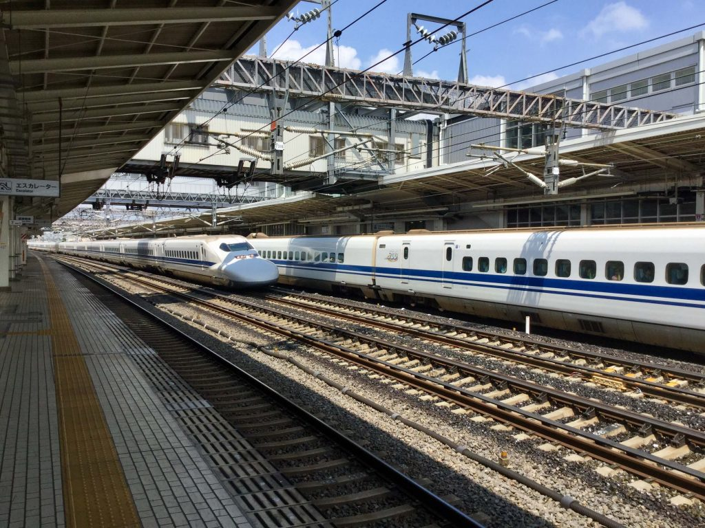 A shinkansen bullet train passing through Maibara Station
