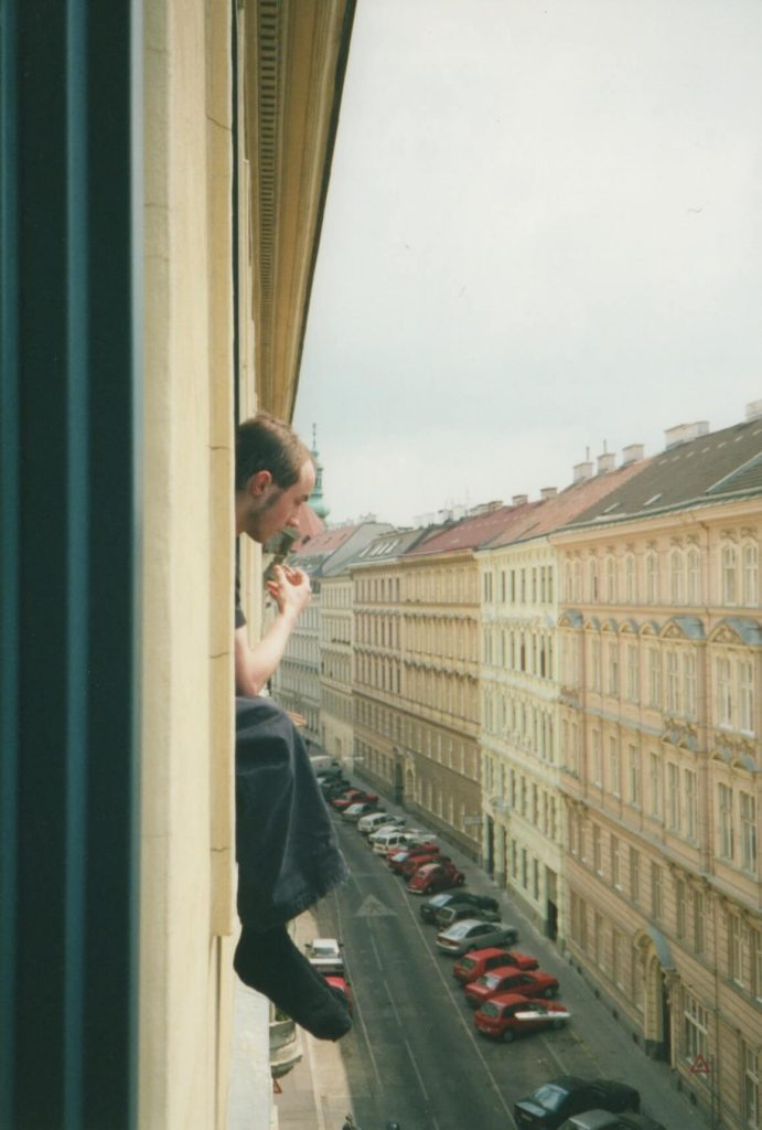 A moment of contemplation high above a Vienna street