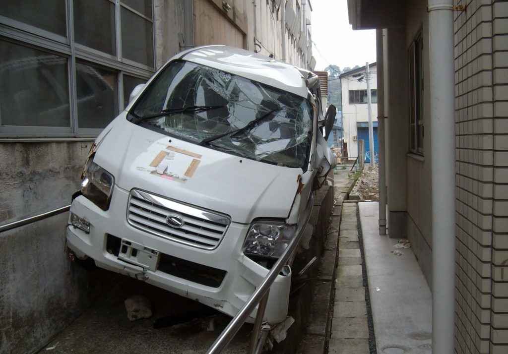 A car trapped between buildings in Ishinomaki after the 2011 tsunami