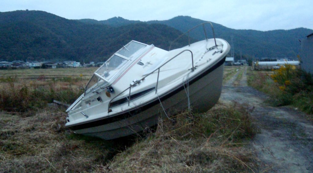 A boat stranded in a field far from the sea in Ishinomaki after the 2011 tsunami