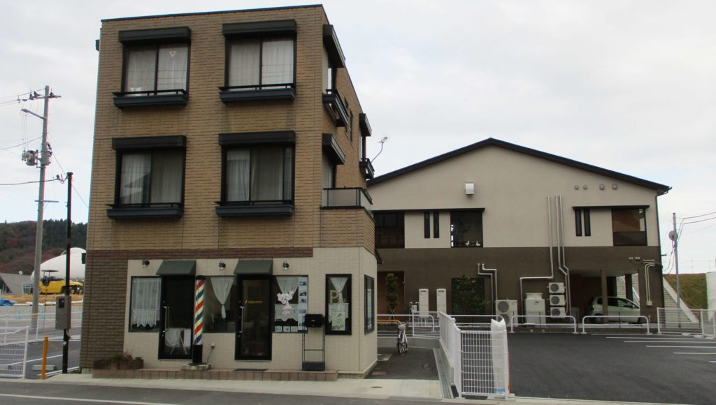 The restored building I worked on during my first volunteer trip in Ishinomaki, with a brand new structure behind it