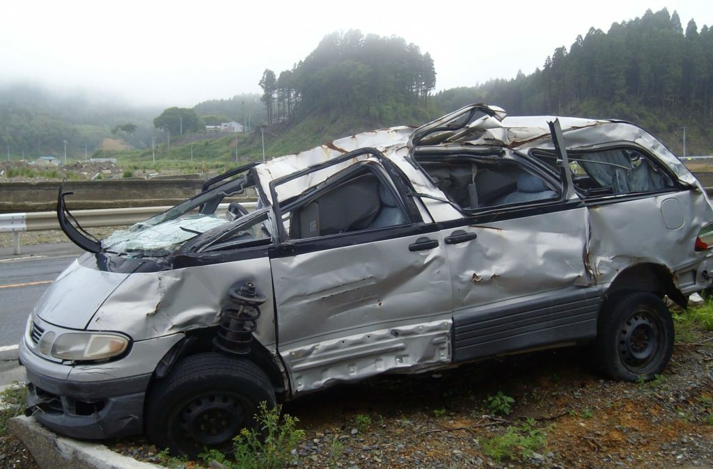A damaged car near Minami Sanriku