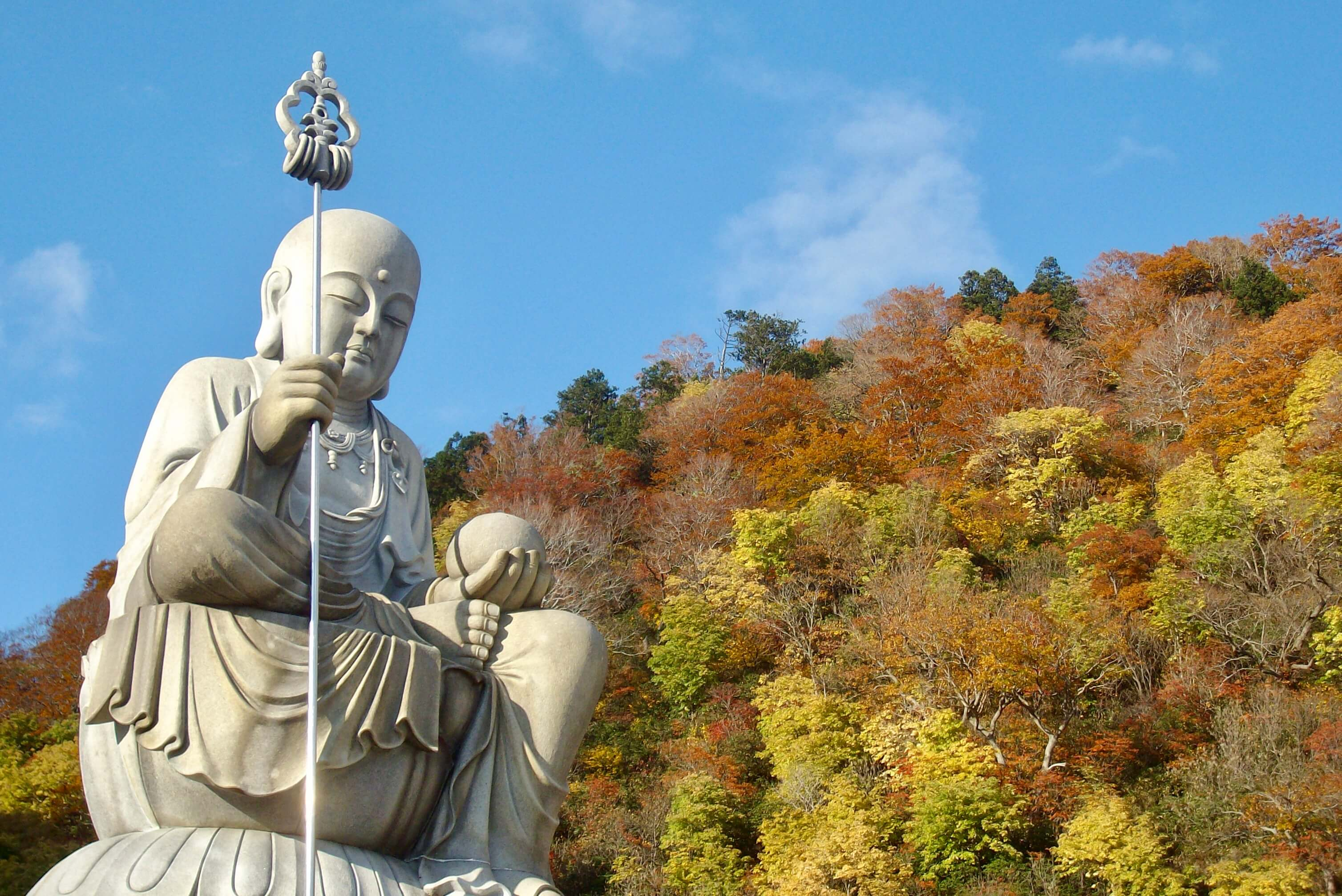 Buddha statue and autumn colours at Osorezan, Aomori