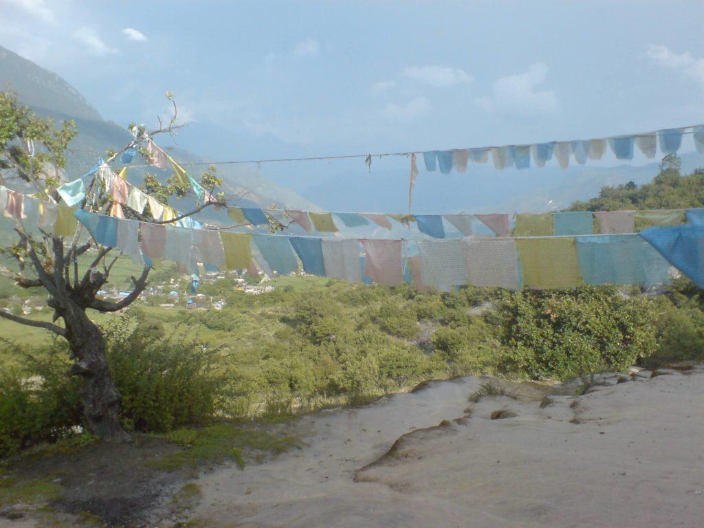 Rock pools and prayer flags at Baishuitai